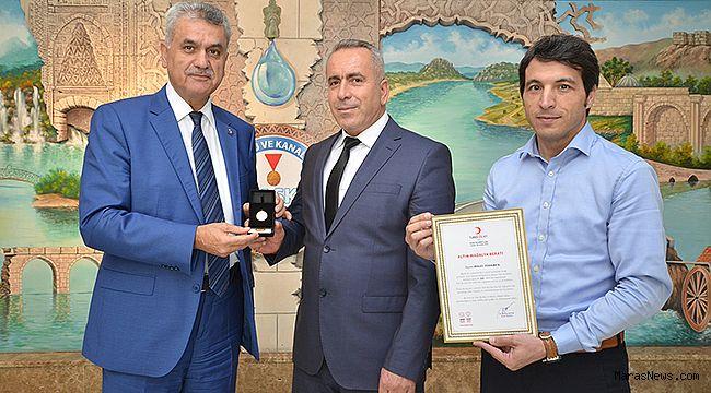 Mikail Türkmen'e Kızılay'dan Altın madalya